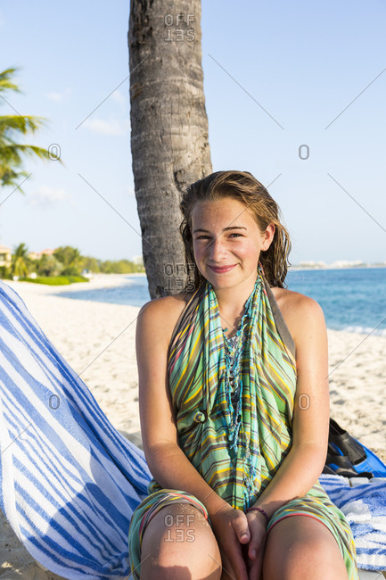 A teenage girl sitting in a beach chair