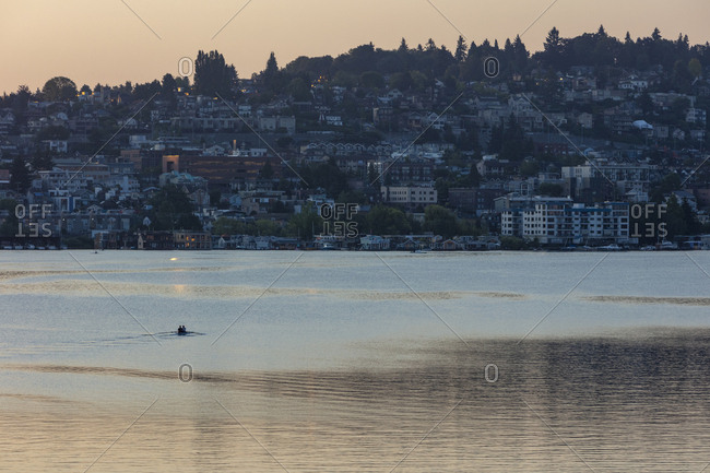Crew racers rowing double scull boat on Lake Union at dawn, Seattle, Washington, USA.
