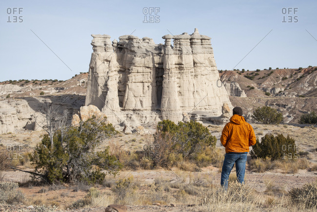 Man overlooking Plaza Blanca in the Rio Chama hills, New Mexico