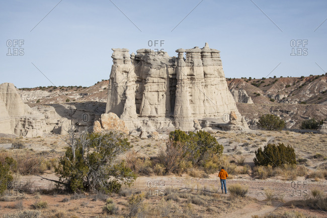 Hiker overlooking Plaza Blanca in the Rio Chama hills, New Mexico