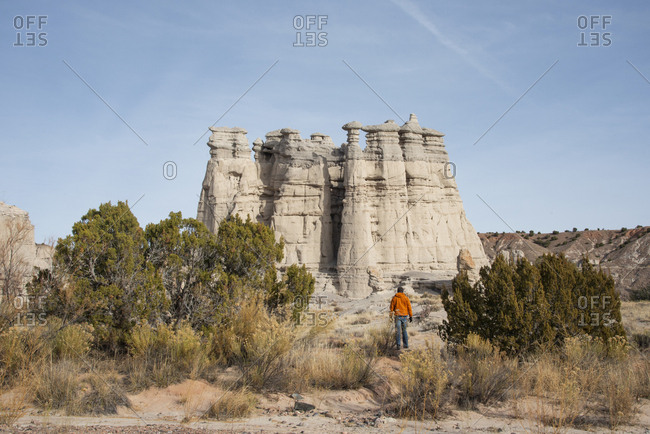 Hiker looking at buttes at Plaza Blanca in the Rio Chama hills, New Mexico