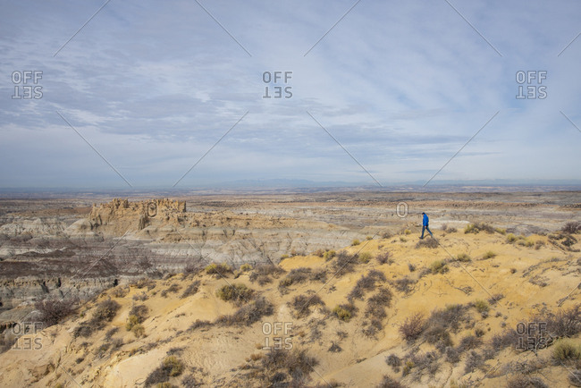 Man walking in the Angel Peak Scenic Area in northwest New Mexico