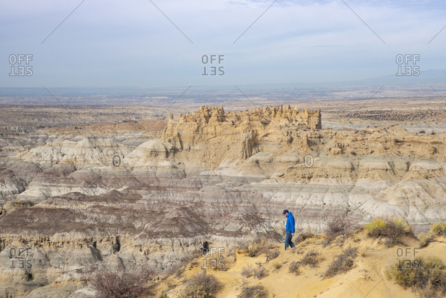 Man hiking in the Angel Peak Scenic Area in northwest New Mexico