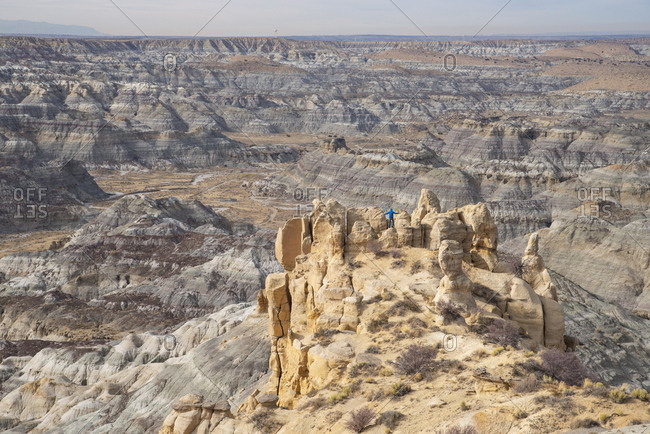 Man standing on cliff overlooking the Angel Peak Scenic Area in northwest New Mexico