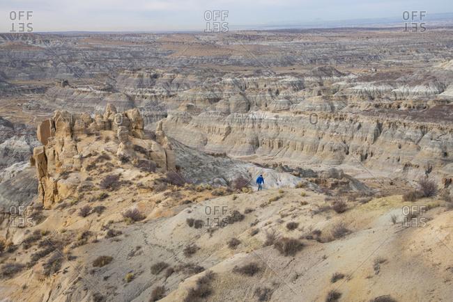 Man hiking through Angel Peak Scenic Area in northwest New Mexico