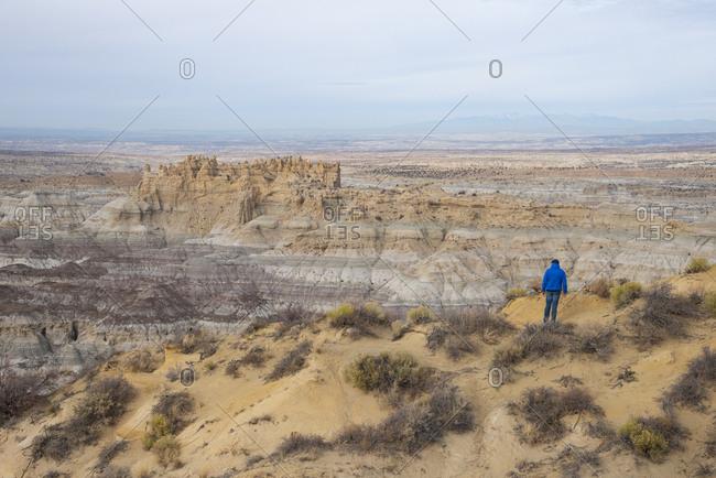 Man overlooking the Angel Peak Scenic Area in northwest New Mexico