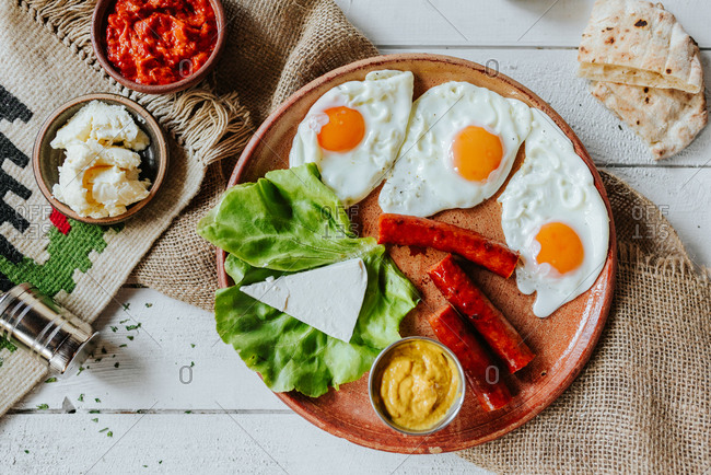 A traditional Serbian breakfast of Fried eggs with sausages