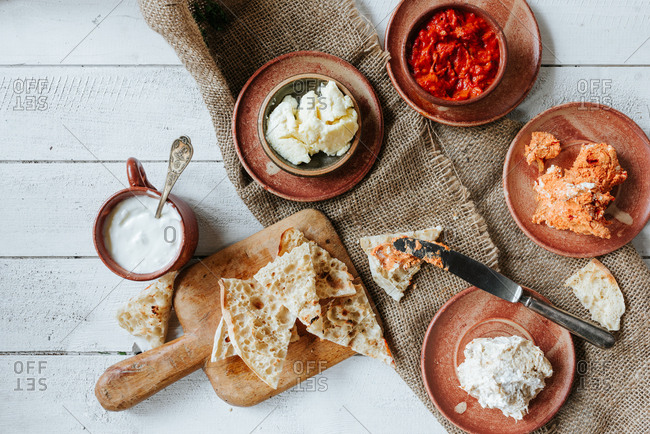 Traditional Serbian breakfast with different cheese and paprika dips