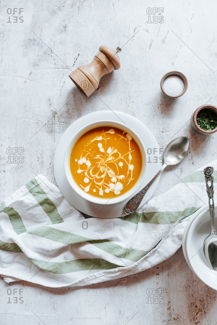 Pumpkin soup in a bowl on white background