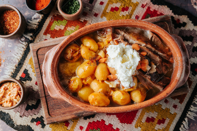 Overhead view of a traditional Serbian meal with potato and meat and vegetables
