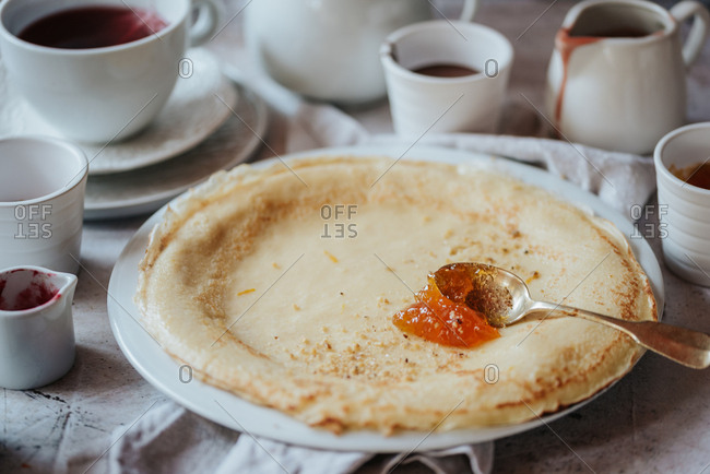 Traditional Serbian crepes with apricot jam