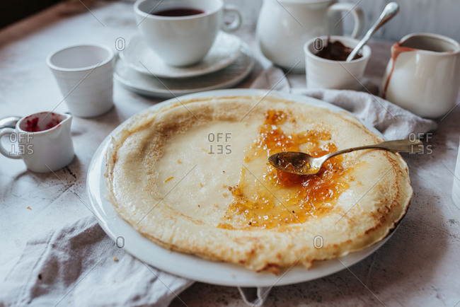 Traditional Serbian crepes with apricot jam and tea