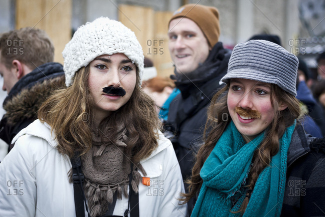 February 23, 2013: Young women with adhesive moustaches at the Hipster Winter Olympiale in Berlin, Germany