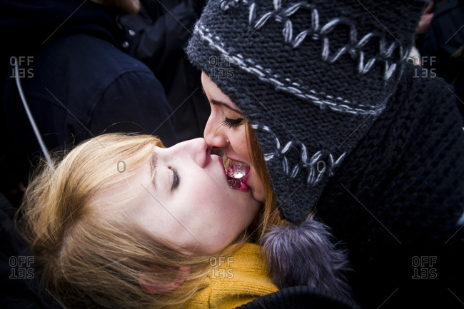 February 23, 2013: Young women kissing with ice cubes at the Hipster Winter Olympiale in Berlin, Germany