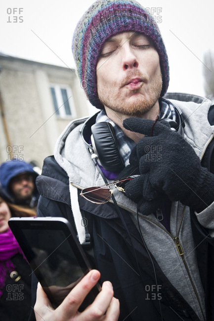February 23, 2013: A young man taking a selfie at the Hipster Winter Olympiale in Berlin, Germany