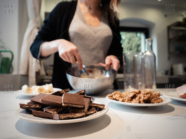 Woman baking a chocolate cake in kitchen