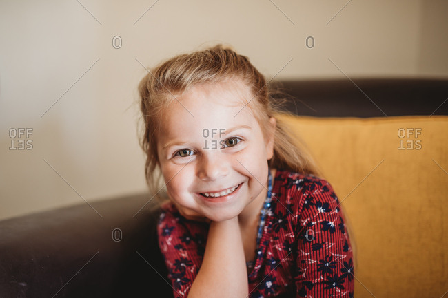 Portrait of a sweet little girl with blonde hair and brown eyes