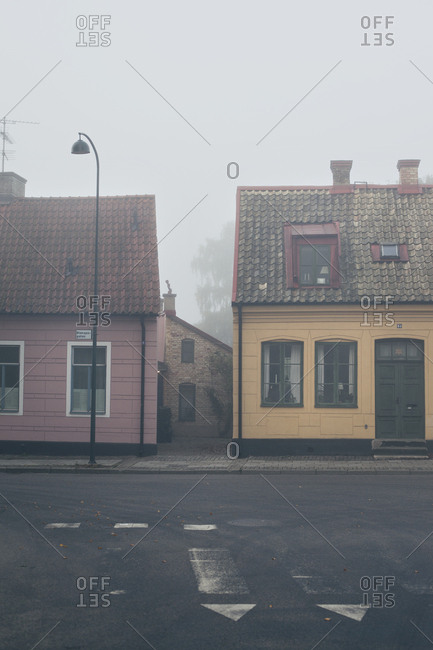 Lund, Sweden - September 22, 2019: Foggy morning on street with colorful small houses