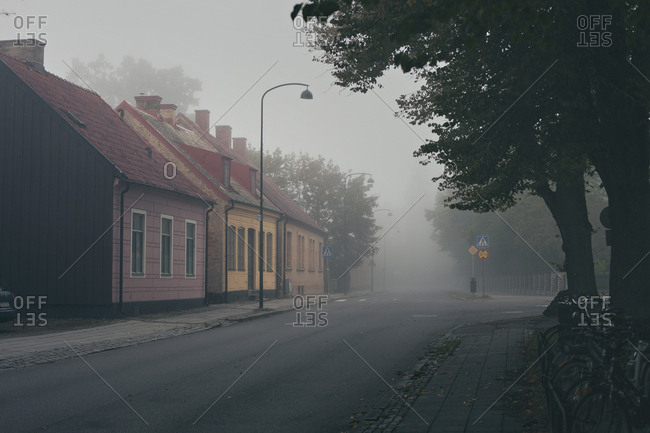 Lund, Sweden - September 22, 2019: A foggy morning on street with colorful small houses