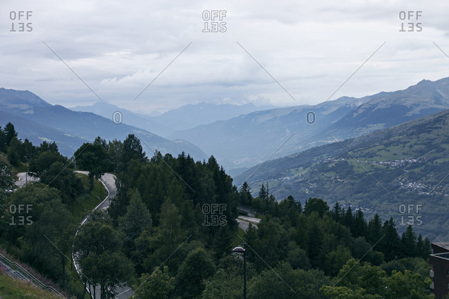 Aerial view over French Alps landscape with road