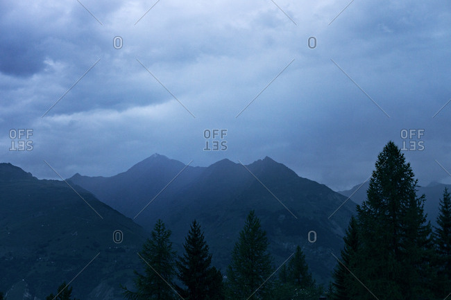 Soft blue mountain landscape during sunset