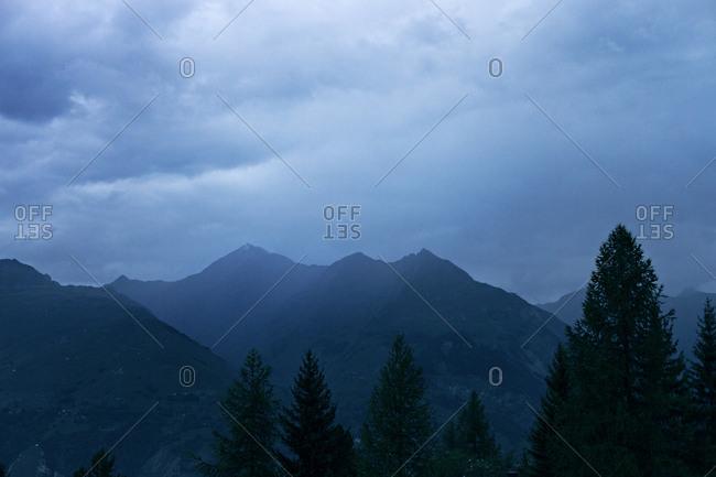 Soft blue mountain landscape during sunset