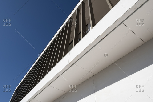 Low angle view of an industrial building against blue sky