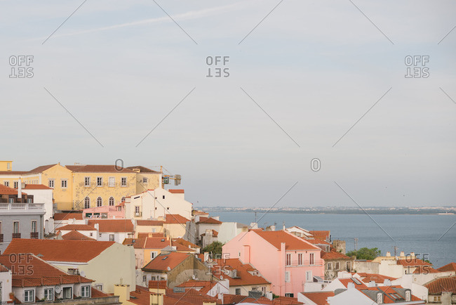 Lisbon, Portugal - April 13, 2017: Elevated view over colorful homes on the Tagus River