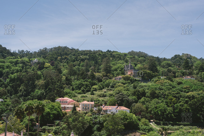 Sintra, Portugal - May 20, 2017: Elevated view of buildings surrounded by lush trees from Montserrat Palace