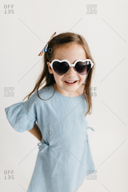 Portrait of a cute little girl wearing heart sunglasses