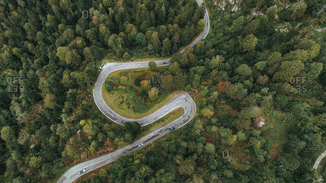 Winding highway surrounded by colorful trees in early fall