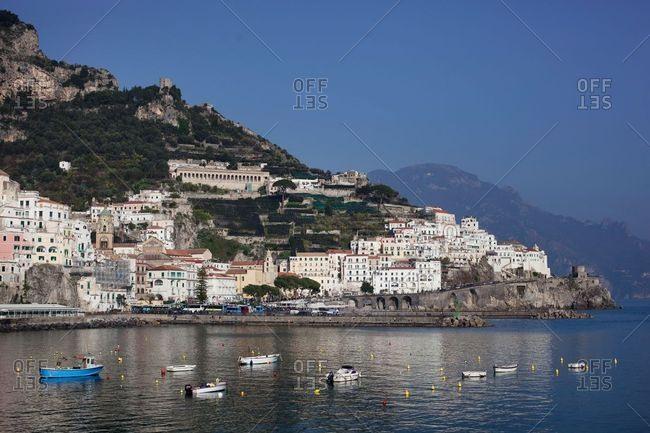 Amalfi, Italy - February 16, 2017: View of the Amalfi coast and boats in the harbor