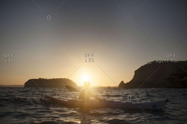 Naples, Italy - June 1, 2018: Silhouette of a kayaker at sunset