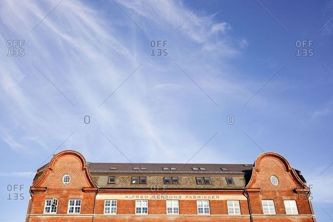 Copenhagen, Denmark - October 4, 2019: Low angle view of an old red brick building