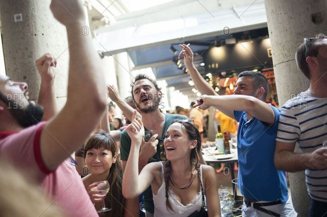 Barcelona, Spain - June 25, 2019: People singing and dancing at La Boqueria, the most popular food market