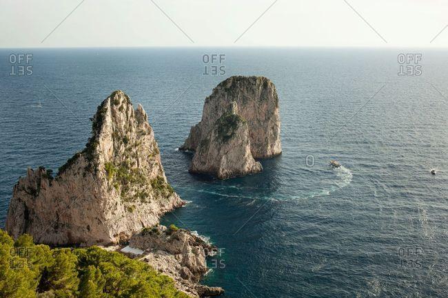Faraglioni seen from coast of Capri, Italy