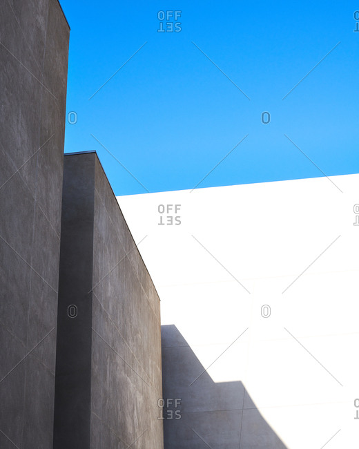Minimal hard light texture exteriors of buildings in San Diego, California showing blue sky above