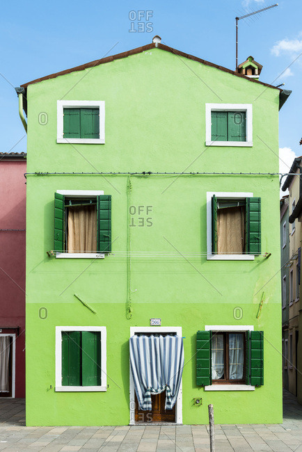 green painted house in Burano
