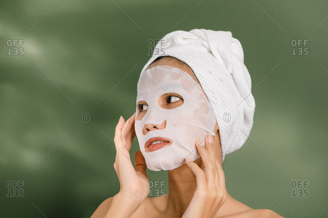 Pretty woman using a face mask