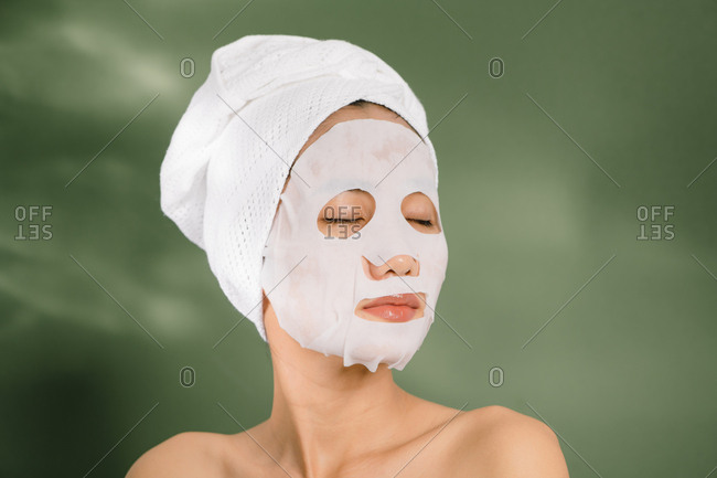 Woman relaxing with a face mask