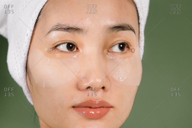 Close up of young woman wearing eye mask