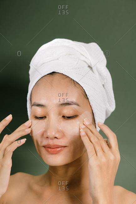 Beauty portrait of relax Asian woman wearing eye masks