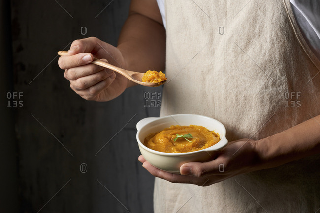 Close up of freshly made pumpkin soup served in a bowl