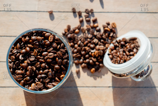 Coffee beans in glass jar on wooden table