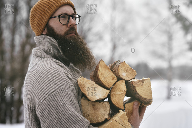 Man holding fire wood
