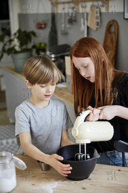 Children using electric mixer - Offset