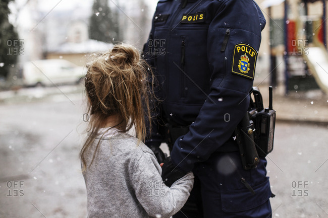 Police woman hugging daughter