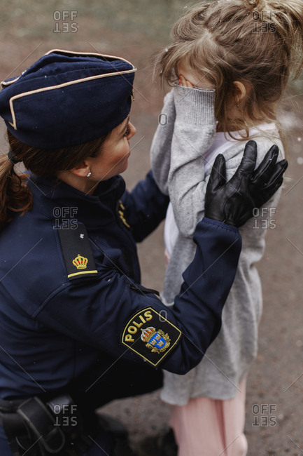 Police woman with daughter