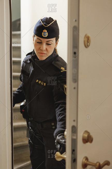 Police woman opening door