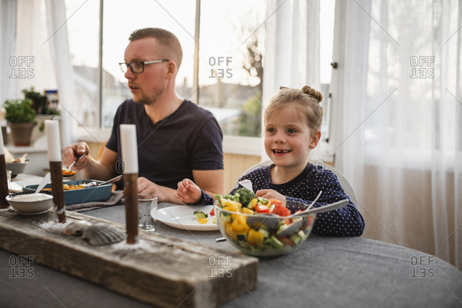 Father and daughter having meal
